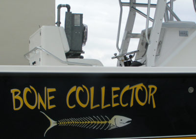 Signs & Stripes Custom Boat Name Bone Collector
