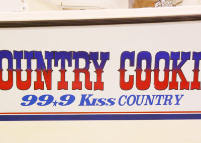 Signs & Stripes Custom Boat Name Country Cookin' 99.9 Kiss Country